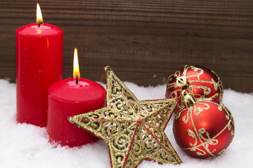 Christmas card with candles and Christmas decorations in the snow