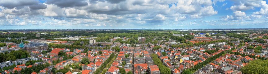 Panoramic downtown  view with houses and cloudy sky. Delft, Holl