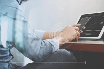 success businessman hand using smart phone,digital tablet dockin