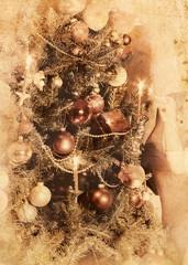 Retro Xmas background with Christmas tree. Black and white retro on old yellow kraft paper.