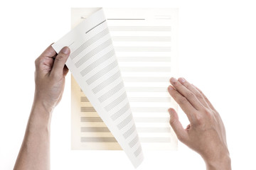 A man(male) write a empty(blank, vacant) paper(music score) isolated white.
