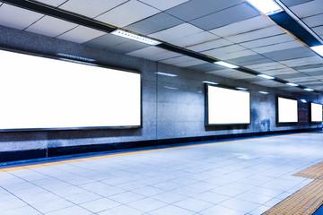 modern hallway of airport or subway station with blank billboards on wall,Hong Kong,china.