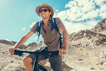 Bike traveler portrait in mountain