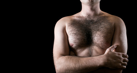 Man with hairy chest isolated on black background for text.