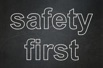 Security concept: Safety First on chalkboard background
