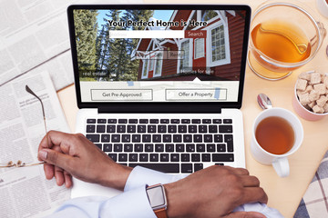 Businessman looking at a Real Estate website - Searching for a house