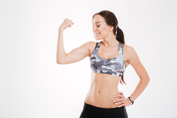 Fitness woman showing bicep