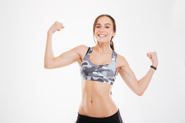 Aerobic woman showing biceps
