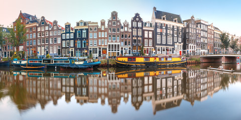 Printed kitchen splashbacks Amsterdam Panorama of Amsterdam canal Singel with typical dutch houses, bridge and houseboats during morning blue hour, Holland, Netherlands.