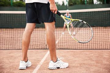 Legs of tennis man