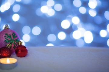 christmas background, toys with candle on snow