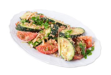 Fresh tomato salad with walnuts and cucumbers.