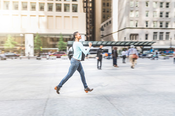 Panning view of a woman running in the city
