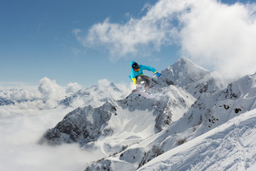 Fotobehang Nepal Snowboard rider jumping on mountains. Extreme snowboard freeride sport.