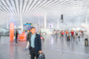 people walking in a busy airport in Shenzhen,China.