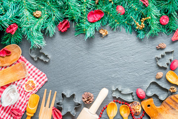 Christmas Cooking Utensils and Christmas Tree on Dark Stone Background, Top View with Free Space for your Text