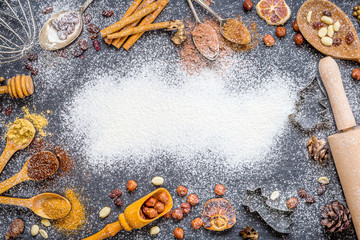 Christmas Background with Spices, Nuts, Rosines, Ginger, Cocoa Powder, Dried Oranges on Dark Stone Background with Free Space for You Christmas Text, Christmas Wallpaper