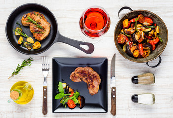 Steak Meat with Grilled Vegetables and Glass of Rose Wine