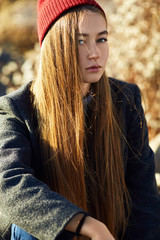 Portrait of a beautiful brunette girl outdoors in hat, lifestyle