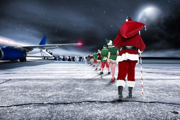 santa claus and people on airport