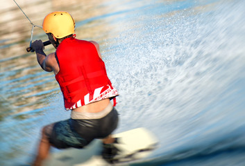 Man on wakeskate doing tricks. Cable Wakeboard. Wall mural