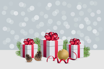 Christmas gift boxes wirh decorations and fir branches on silver bokeh background horizontal composition