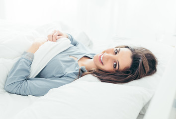 Cute woman in the bed
