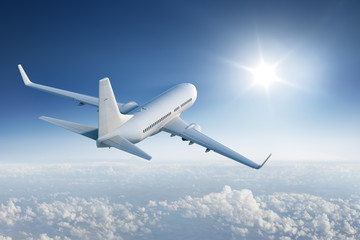 Airliner flying towards the sun in blue sky Wall mural