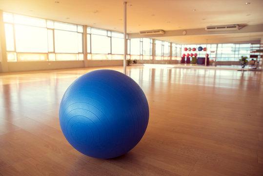 exercise ball for fitness on wooden floor
