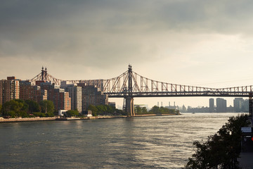 A view down East River from north with Queensboro bridge and the housing on Roosevelt Island in the foreground