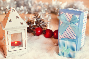 Gift boxes surrounded by Christmas decorations