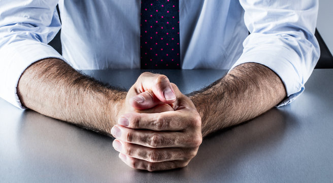 concept of restrained impatience and business self-control with hands