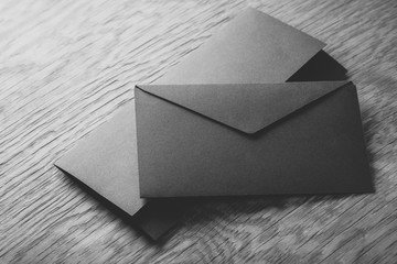 black envelope on  wooden table