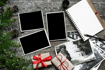 blank photo frames on christmas wooden background