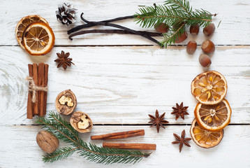 Spicy Christmas background. Anise cinnamon nuts fir tree baking ingredients.