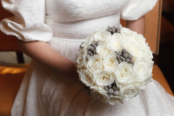 White roses and grey brunia berries bridal bouquet