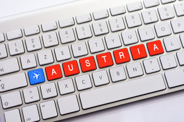 AUSTRIA writing on white keyboard with a aircraft sketch
