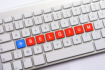 BELGIUM writing on white keyboard with a aircraft sketch
