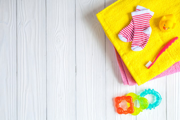 baby accessories for bath on wooden background