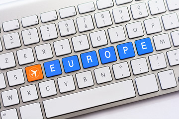EUROPE writing on white keyboard with a aircraft sketch