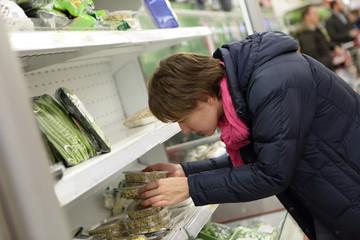 Woman in vegetables market