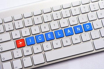 ICELAND writing on white keyboard with a aircraft sketch
