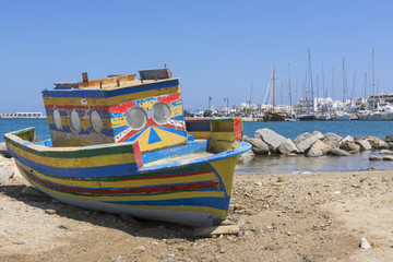 Old abandoned boat in the port of Naxos, Greece