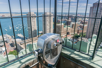 Telescope looking out over the city from the observation deck of the Custom House Tower Boston