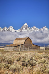 Teton mountain range with Moulton Barn in the Grand Teton National Park, Wyoming, USA.