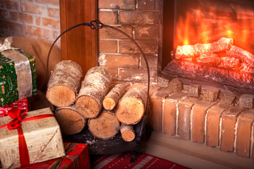 Christmas gifts near fireplace. New Year home interior