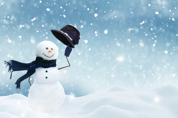 Happy snowman standing in christmas landscape