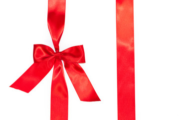 Red vertical gift ribbons and luxurious bow