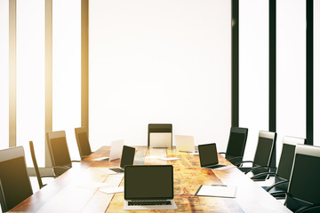 Empty laptops on conference table