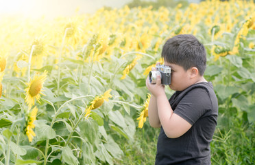 Child Holding old camera to Take Photos sunflower flower